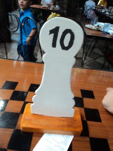 Food please?! :) Chess themed table and number. :)
